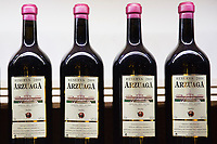 Bottles of red wine of Bodegas Arzuaga Reserva 2009, ribera del Duero wine production by River Duero, Navarro, Spain