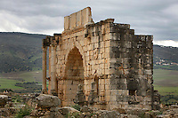Triumphal Arch, Volubilis, Morocco, pictured on December 25, 2009. The massive arch, dominating the surrounding landsacpe, 217 AD, was built in honour of Caracalla, Roman Emperor 211-217. Some of the original decoration is still intact. Around the city fertile plains providing agriculural produce stretch towards the mountains. Volubilis, founded in the 3rd century BC was an important city in the Western part of Roman North Africa. The Romans abandoned it in the 3rd century AD. Excavations were started by the French in 1915, and it became a UNESCO World Heritage site in 1997. Picture by Manuel Cohen