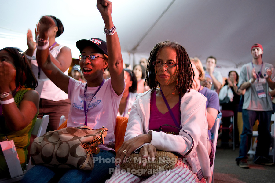 Supporters of Barack Obama, Brenda Rucker (cq, left) and Akwe Starnes (cq) cheer in 5 Points in Denver, Colorado, while watching Barack Obama accept the nomination for President of the United States during the Democratic National Convention, Thursday, August 28, 2008...PHOTOS/ MATT NAGER