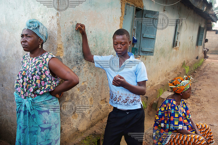 The two wives and a younger son of a man who is currently detained at Bo central police station for a theft allegedly committed by his eldest son.
