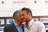 Il capitano della Roma Francesco Totti tiene una conferenza stampa insieme al presidente James Pallotta, a sinistra, in occasione del rinnovo del suo contratto, al centro sportivo Fulvio Bernardini di Trigoria, Roma, 20 settembre 2013.<br /> AS Roma football club captain Francesco Totti  attends a joint press conference with club's president James Pallotta, left, in occasion of the renewal of his contract at the club's sporting center in Rome, 20 September 2013.<br /> UPDATE IMAGES PRESS/Isabella Bonotto