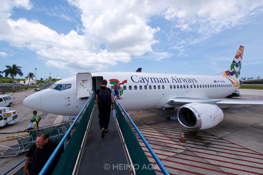 Grand Cayman. Owen Roberts International Airport, George Town. Nicole Schmidt boarding a Cayman Airways Boeing 737.