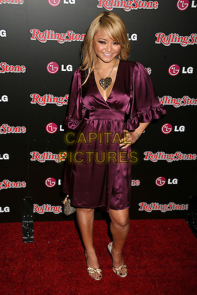 TILA TEQUILA.Rolling Stone Magazine Celebrates the 20th Annual HOT LIST at the Sofitel Hotel's Stone Rose Lounge, Los Angeles, California, USA..October 3rd, 2006.Ref: ADM/BP.full length purple satin dress hand on hip.www.capitalpictures.com.sales@capitalpictures.com.©Byron Purvis/AdMedia/Capital Pictures.