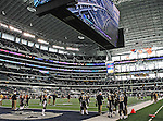 The Dallas Cowboys and St. Louis Rams warm up before the pre- season game between the St. Louis Rams and the Dallas Cowboys at the Cowboys Stadium in Arlington, Texas. Dallas defeats St. Louis  20 to 19.