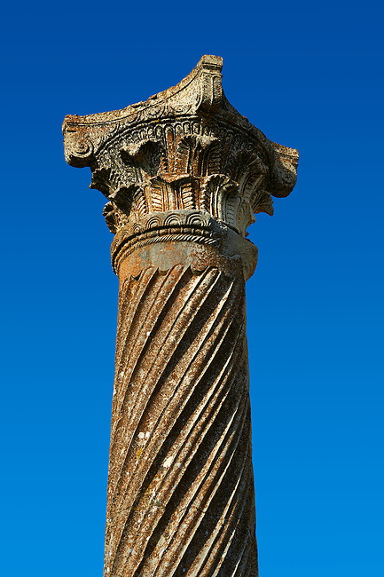 Tiwsted Corintian Roman column and capital. Volubilis Archaeological Site, near Meknes, Morocco