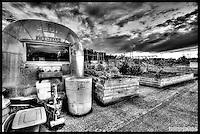 Airstream trailer atop parking garage pea patch garden