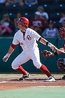 Evan Mistich (9) follows through after hitting during the NCAA matchup between the University of Arkansas-Little Rock Trojans and the University of Oklahoma Sooners at L. Dale Mitchell Park in Norman, Oklahoma; March 11th, 2011.  Oklahoma won 11-3.  Photo by William Purnell/Four Seam Images