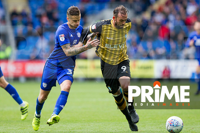 Steven Fletcher of Sheffield Wednesday holds off Joe Bennett of Cardiff City during the Sky Bet Championship match between Cardiff City and Sheffield Wednesday at Cardiff City Stadium, Cardiff, Wales on 16 September 2017. Photo by Mark  Hawkins / PRiME Media Images.