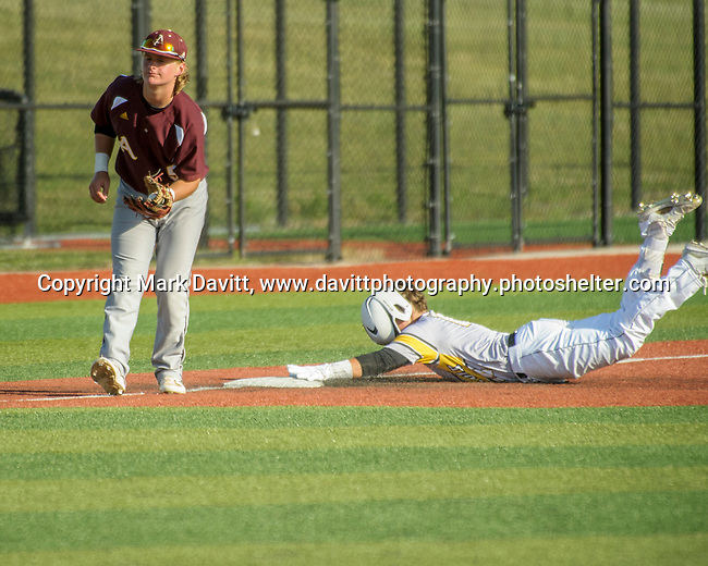Southeast Polk and Ankeny met for a double header at SEP June 21. SEP prevailed twice, 2-0 and 8-1. SEP's Adam Schneider looses his helmet on the slide to third.
