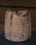 A carved stone piece from the ruins of the Zapotec city of Atzompa in the Museo Comunitario Santa Maria Atzompa, Oaxaca, Mexico.