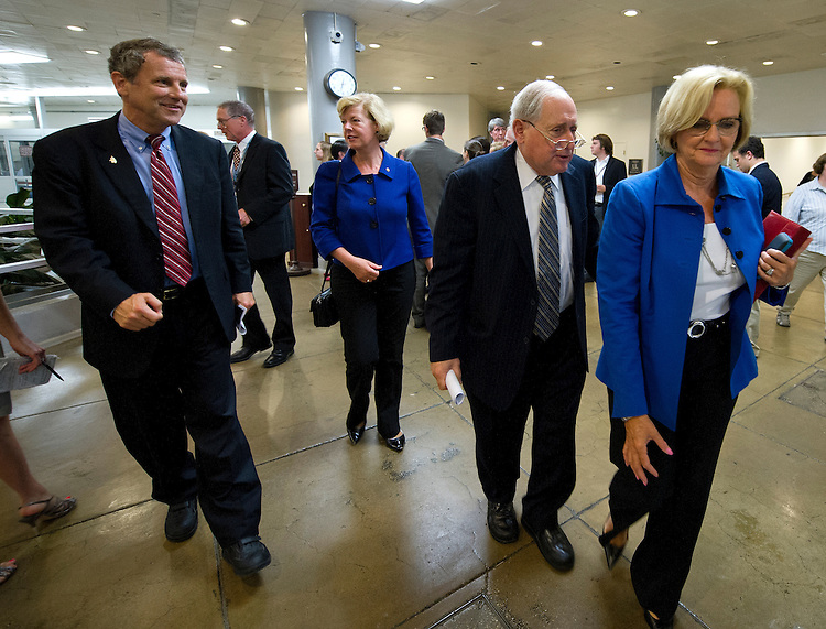UNITED STATES - July 18: Senators Sherrod Brown, D-OH., Tammy Baldwin, D-WI., Carl Levin, D-MI., and Claire McCaskill, D-MO., make his their way to the Senate policy luncheons through the Senate subway in the U.S. Capitol on July 18, 2013. (Photo By Douglas Graham/CQ Roll Call)