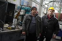 Roma 20 Febbraio 2012.I lavoratori della Rsi Italia SpA (Rail Service Italia, ex Wagons Lits), in Cassa Integrazione straordinaria da 6 mesi hanno occupato la fabbrica di via Umberto Partini a Roma. Sono 59 operai (33 metalmeccanici, 26 dei trasporti), addetti alla manutenzione dei Treni Notte..Salvatore, caposquadra e Massimo, operaio..Workers at the Rsi Italy SpA (Italy Rail Service, former Wagons Lits), extraordinary layoff from 6 months have occupied the factory in via Umberto Partini in Rome. We are 59 workers (33 metalworkers, 26 transport), Night Train maintenance workers. Rome, Italy 20th of February 2012