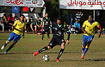 Palestinian Shabab Jabalia football club players (in yellow) and al-Hilal football club players (in black) compete during a football match at Beit Lahia Stadium in the northern Gaza Strip on March 11, 2018. Photo by Mahmoud Ajour