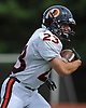 Manhasset running back No. 23 Jack Miller returns a kick during the first quarter of a Nassau County Conference II varsity football game against host Garden City High School on Saturday, September 12, 2015. He scored two touchdowns in defeat as Garden City won by a score of 38-14.<br /> <br /> James Escher