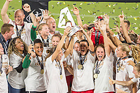 Orlando, FL - Saturday October 14, 2017: Tobin Heath,Christine Sinclair, Portland Thorns FC celebrating the victory during the NWSL Championship match between the North Carolina Courage and the Portland Thorns FC at Orlando City Stadium.