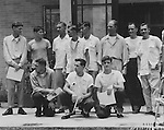 "HQ. FEAF, Tokyo --- Shown after their return to freedom in Hongkong are eleven U.S. Air Force officers and airmen, crew members of a B-29 ""Superfort"" show down in January 1953 during a leaflet dropping mission over North Korea. From left to right, front row: T/Sgt. Howard M. Brown, St. Paul, Minn. Standing, left to right; Col. John K. Arnold, Jr., Montgomery, Alabama; A/1C Steve E. Kiba, Akron, Ohio; Capt. John M. Buck, Arthwaite, Tenn.; A/C2 John W. Thompson III, Orange, VA.,; 1st Lt. Wallace L. Brown, Montgomery, Ala.; Capt. Eugene J. Vaadi, Clayton, N.Y.; Major William H. Baumer, Lewisburg, Pa.; and Capt. Elmer F. Llewellyn, Missoula, Mont. In the picture they are still in their ""prison"" clothing. Later they entered the Jockey Club in Hongkong got a bath, shave new clean clothing and steak dinner. August 1955."