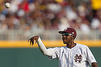 Mississippi State outfielder Demarcus Henderson (2) tosses the ball to a fan during Game 1 of the 2013 Men's College World Series Finals against the UCLA Bruins on June 24, 2013 at TD Ameritrade Park in Omaha, Nebraska. The Bruins defeated the Bulldogs 3-1, taking a 1-0 lead in the best of 3 series. (Andrew Woolley/Four Seam Images)