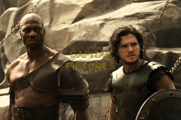 Adewale Akinnuoye-Agbaje, Kit Harington<br /> in Pompeii (2014) <br /> *Filmstill - Editorial Use Only*<br /> CAP/FB<br /> Image supplied by Capital Pictures