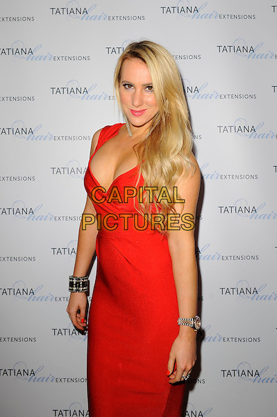 Rebecca Ferdinando<br /> The Tatiana Hair Extensions LFW Avant Garde Catwalk Collection, Tatiana Hair Extensions, Kensington, London, England. <br /> 11th September 2013<br /> fashion week half length red dress  cleavage <br /> CAP/MAR<br /> &copy; Martin Harris/Capital Pictures