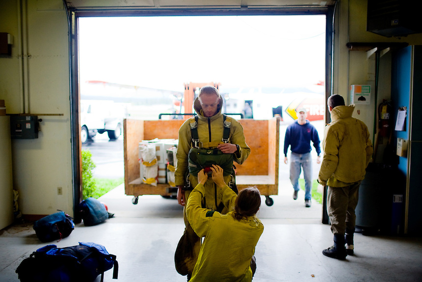 McCall Smokejumper Lane Lamoreaux prepares for his first jump out of an airplane during a training session prior to the 2010 fire season.