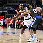 SIOUX FALLS, SD: MARCH 5: 	Tra-Deon Hollins #24 from Omaha passes the ball around Mo Evans #0 from Fort Wayne during the Summit League Basketball Championship on March 5, 2017 at the Denny Sanford Premier Center in Sioux Falls, SD. (Photo by Dave Eggen/Inertia)