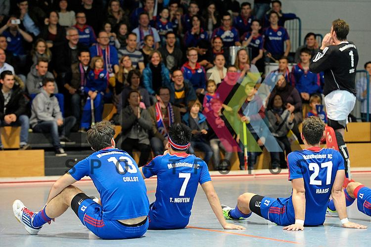 GER - Mannheim, Germany, December 12: Players of Mannheimer HC celebrate after winning the derby against TSV Mannheim on December 12, 2015 at Irma-Roechling-Halle in Mannheim, Germany. Final score 5-0 (HT 1-0).  (r) Andreas Spaeck #1 of Mannheimer HC<br /> <br /> Foto &copy; PIX-Sportfotos *** Foto ist honorarpflichtig! *** Auf Anfrage in hoeherer Qualitaet/Aufloesung. Belegexemplar erbeten. Veroeffentlichung ausschliesslich fuer journalistisch-publizistische Zwecke. For editorial use only.