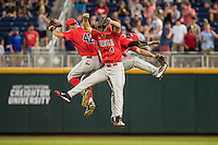 Arizona Wildcats outfielders celebrate during a College World Series Finals game between the Coastal Carolina Chanticleers and Arizona Wildcats at TD Ameritrade Park on June 27, 2016 in Omaha, Nebraska. (Brace Hemmelgarn/Four Seam Images)