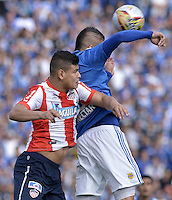 BOGOTA - COLOMBIA -05 -06-2016: Michael Rangel (Der) jugador de Millonarios disputa el balón con Alexis Perez (Izq) jugador de Atlético Junior durante partido de vuelta de los cuadrangulares finales de la Liga Aguila I 2016 jugado en el estadio Nemesio Camacho El Campin de la ciudad de Bogota./ Michael Rangel (R) player of Millonarios fights for the ball with Alexis Perez (L) player of Atletico Junior during the second leg match of the finals quadrangular of the Liga Aguila I 2016 played at the Nemesio Camacho El Campin Stadium in Bogota city. Photo: VizzorImage / Gabriel Aponte / Staff.