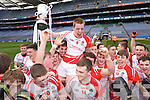 Barra Ó Súilleabháin Pobalscoil Chorca Duibhne captain celebrates defeating St.Patrick's College Maghera in the Hogan Cup Final, in Croke Park, Dublin on Saturday.
