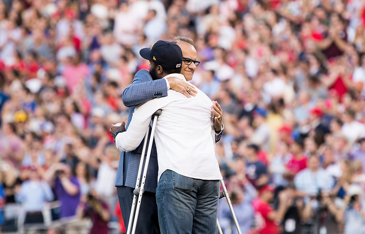 UNITED STATES - JUNE 15: Former New York Yankees manager Joe Torre gives a hug to David Bailey, one of the the injured Capitol Police officers on Rep. Steve Scalise's security detail, before Bailey threw out the first pitch at the annual Congressional Baseball Game at Nationals Park in Washington on Thursday, June 15, 2017. (Photo By Bill Clark/CQ Roll Call)