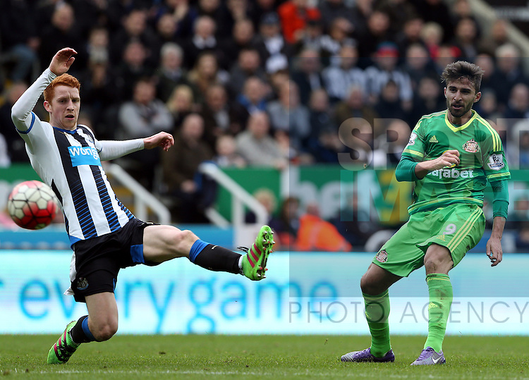 Sunderland's Fabio Borini, right, has a shot towards goal past Newcastle United's Jack Colback, left, during the Barclays Premier League match at St James' Park Stadium. Photo credit should read: Scott Heppell/Sportimage