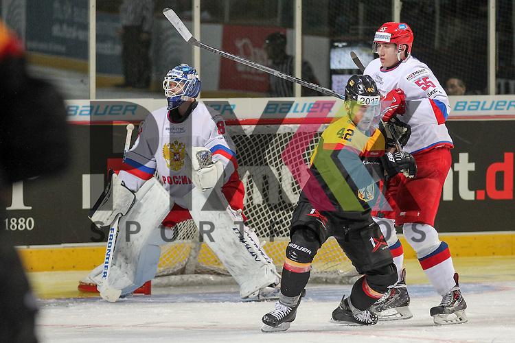 Russlands Lyubushkin Ilya Nikolayevich (Nr.55)(Lokomotiv) im Zweikampf mit Deutschlands Ehliz, Yasin (Nr.42)(Thomas Sabo Ice Tigers) vor Russlands Sharychenkov Alexander Mikhaylovich (Nr.83)(Dynamo Moscow) im Spiel IIHF WC15 Germany - Russia.<br /> <br /> Foto &copy; P-I-X.org *** Foto ist honorarpflichtig! *** Auf Anfrage in hoeherer Qualitaet/Aufloesung. Belegexemplar erbeten. Veroeffentlichung ausschliesslich fuer journalistisch-publizistische Zwecke. For editorial use only.