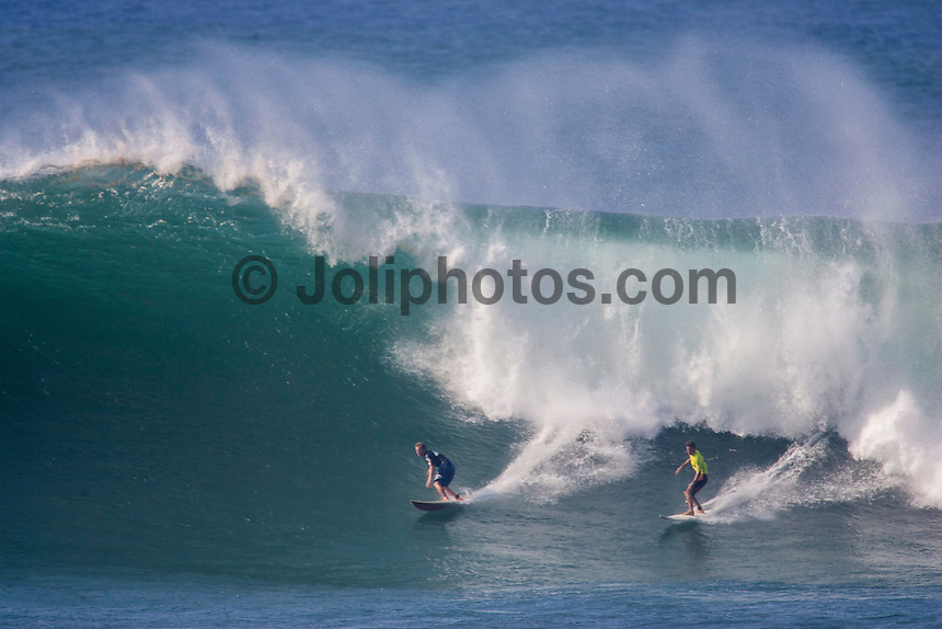 Waimea Bay, North Shore, Oahu, Hawaii December 15 2004.<br /> Ross Williams (HAW) and Andy Irons (Haw) - The 2004 Quiksilver Eddie Aikau Big Wave Invitational won by Hawaiian surfer Bruce Irons (HAW) from the island of Kauai was held in 30 to 40' waves at Waimea Bay on the North Shore of Oahu Hawaii, today, December 15th 2004. Irons rode one of the biggest waves of the day which was at least 30' in height, taking home US$55,000 in prize money.  Photo: Joliphotos.com