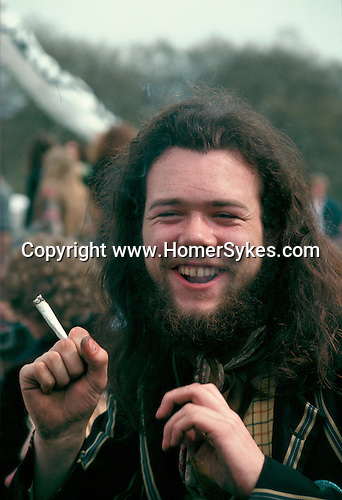LONG HAIRED, BEARDED MAN, SMOKING A JOINT AT A DEMO TO LEGALISE POT, HYDE PARK, LONDON, 1979,