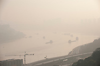Daytime Landscape View Of Commercial Freighters in the Yangtze River In Chongqing, China.  © LAN