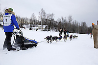 Alea Robinson and dog team leaves the start line of the 2013 Junior Iditarod on Knik Lake.  Knik Alaska..Photo by Jeff Schultz/IditarodPhotos.com   Reproduction prohibited without written permission