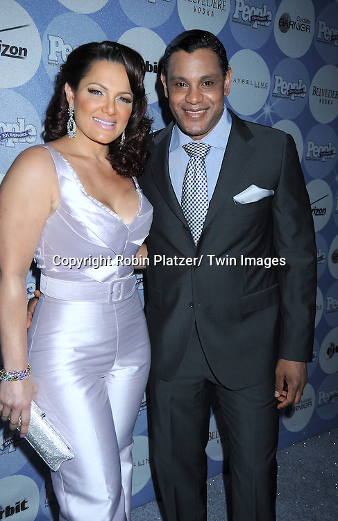 "Sonia and Sammy Sosa posing for photographers at the 14th Annual People En Espanol's ""50 Most Beautiful"" issue on May 20, 2010 at .Guastavino's in New York City."