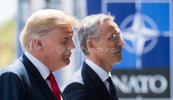 11 July 2018, Brussels, Belgium: Donald Trump, President of the United States of America,  arrives at the NATO summit and is received by Jens Stoltenberg, NATO Secretary General. From 11 July 2018 until 12 July 2018 government heads of the 29 NATO member states and European Union representatives, will participate in the Summit of the North Atlantic Treaty Organization. Photo: Bernd von Jutrczenka/dpa /MediaPunch ***FOR USA ONLY***