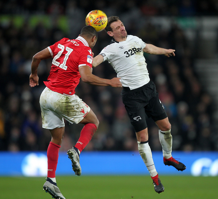 Derby County's Craig Bryson jumps with Nottingham Forest's Saidy Janko<br /> <br /> Photographer Mick Walker/CameraSport<br /> <br /> The EFL Sky Bet Championship - Derby County v Nottingham Forest - Monday 17th December 2018 - Pride Park - Derby<br /> <br /> World Copyright © 2018 CameraSport. All rights reserved. 43 Linden Ave. Countesthorpe. Leicester. England. LE8 5PG - Tel: +44 (0) 116 277 4147 - admin@camerasport.com - www.camerasport.com
