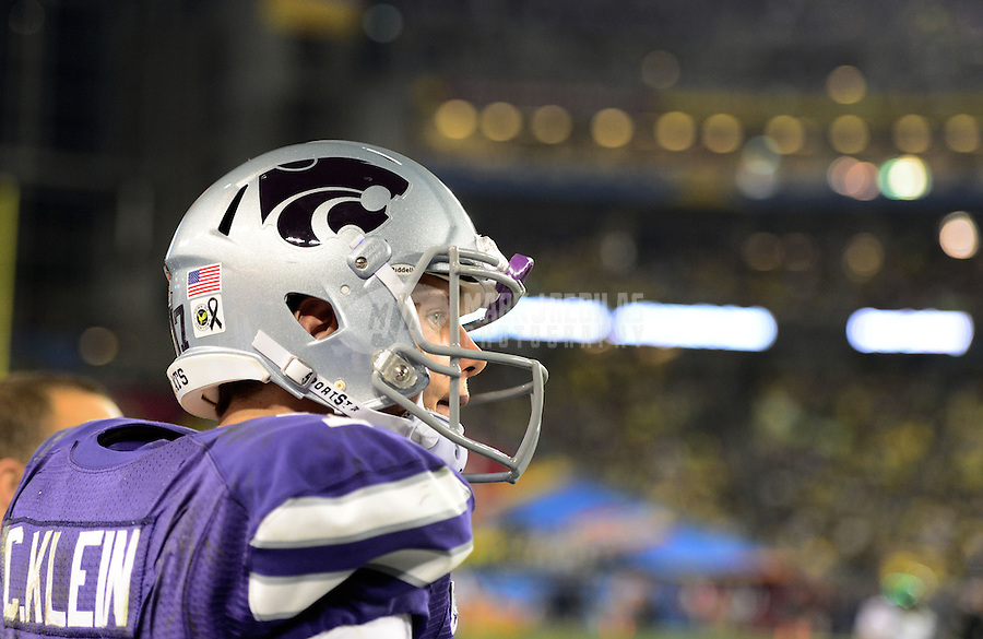Jan. 3, 2013; Glendale, AZ, USA: Kansas State Wildcats quarterback Collin Klein (7) against the Oregon Ducks in the second half during the 2013 Fiesta Bowl at University of Phoenix Stadium. Oregon defeated Kansas State 35-17. Mandatory Credit: Mark J. Rebilas-