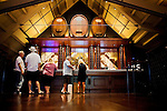 Guests mingle in the mezzanine tasting room at Francis Ford Coppola Winery, in Geyserville, Ca., on Saturday, July 31, 2010.