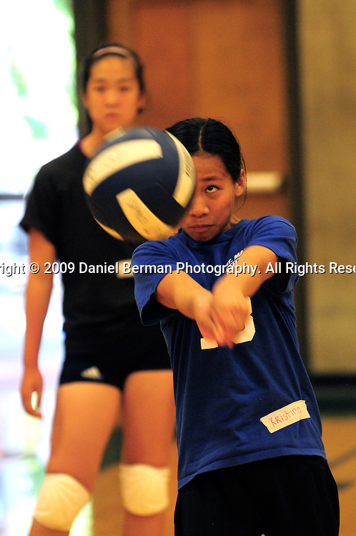 Daniel Berman/Special to The Enterprise..Kristina Mangaliag practices her passing skills, as Ashley Gordon (in background) looks on, during a youth volleyball camp held Monday July 27 at Shoreline Community College...Shoreline, WA