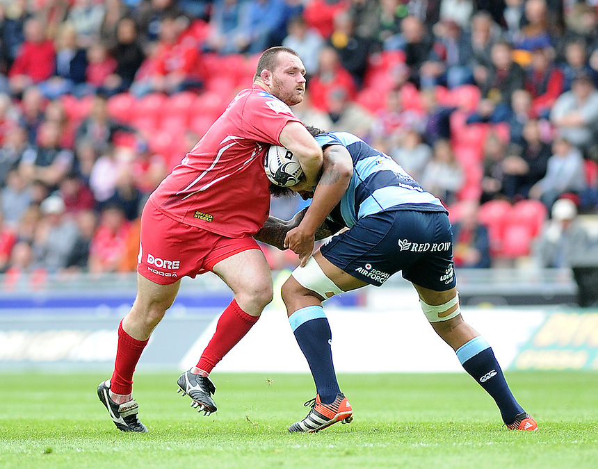 Scarlets' Ken Owens is tackled by Cardiff Blues' Filo Paulo<br /> <br /> Photographer Ashley Crowden/CameraSport<br /> <br /> Rugby Union - Guinness PRO12 - Scarlets v Cardiff Blues - Sunday 10th May 2015 - Parc y Scarlets - Llanelli<br /> <br /> &copy; CameraSport - 43 Linden Ave. Countesthorpe. Leicester. England. LE8 5PG - Tel: +44 (0) 116 277 4147 - admin@camerasport.com - www.camerasport.com