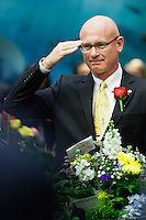 TALLAHASSEE, FLA. 3/4/14-Rep. Cary Pigman, R-Avon Park, salutes the military honor guard during the opening day of the legislative session, March 4, 2014 at the Capitol in Tallahassee.<br /> <br /> COLIN HACKLEY PHOTO