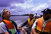 Tataquara, Brazil. Tourists in lifejackets on the boat to the ecotourism hotel lodge.