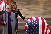 Jenna Bush Hager, the daughter of former President George Bush, touches the casket of former President George H.W. Bush after speaking at his State Funeral at the National Cathedral, Wednesday, Dec. 5, 2018, in Washington. <br /> Credit: Andrew Harnik / Pool via CNP