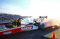 Aug 15, 2014; Brainerd, MN, USA; NHRA top fuel dragster driver Steve Torrence (near lane) does his burnout alongside Khalid Albalooshi during qualifying for the Lucas Oil Nationals at Brainerd International Raceway. Mandatory Credit: Mark J. Rebilas-