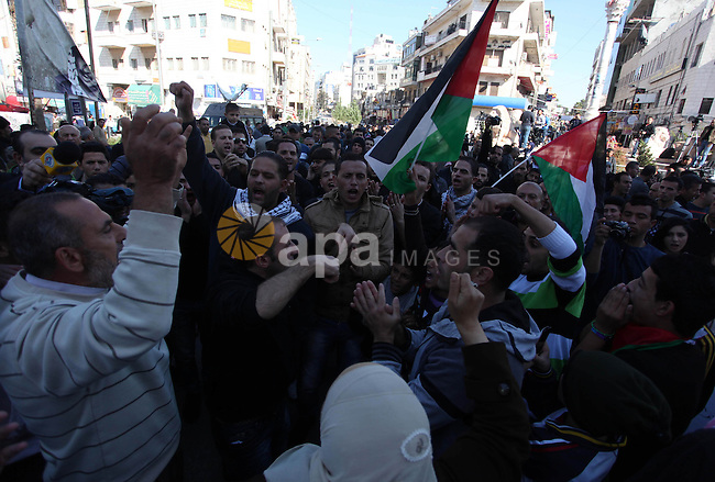 Palestinian activists hold their national flags during a protest against the Israeli military operations in Gaza strip, in the West Bank city of Ramallah on November 15, 2012. Several Palestinians were killed following a series of Israel's concurrent airstrikes on Gaza city, among them was Ahmed al-Jaabari, top commander of Hamas armed wing Al-Qassam brigades, and more than 150 others wounded, government's emergency services in the Gaza Strip said. Photo by Issam Rimawi