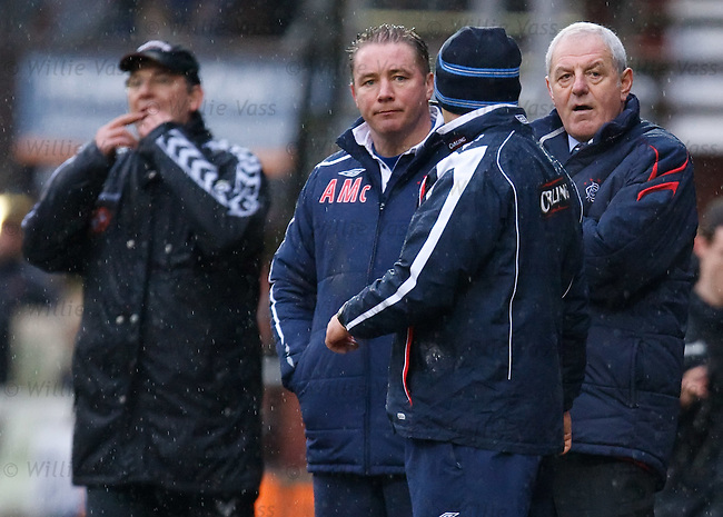 Walter Smith and Ally McCoist look on as Craig Levein encourages his team