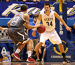 BROOKINGS, SD - JANUARY 18:  Marcs Tyus #23 from Omaha looks to drive against Cody Larson #34 from South Dakota State University in the first half of their Summit League game Saturday afternoon at Frost Arena in Brookings. (Photo by Dave Eggen/Inertia)